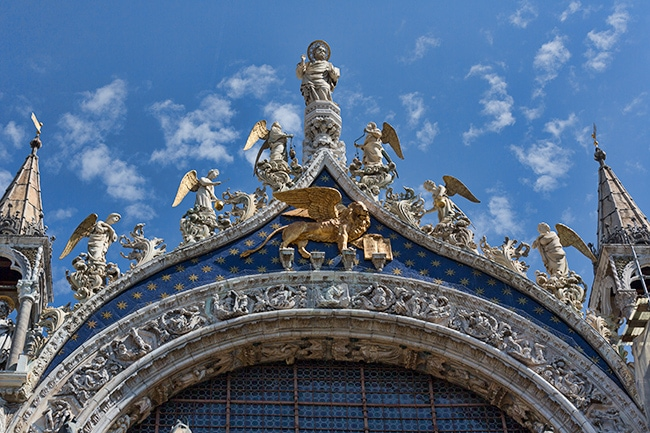 Detail of the gable showing Venice's patron apostle St. Mark with angels. Underneath is a winged lion