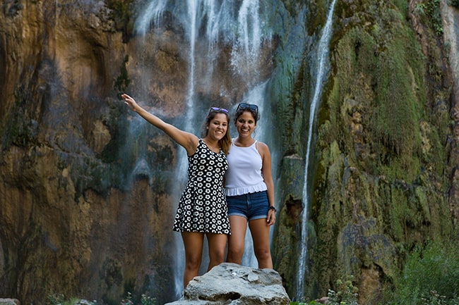Posing at the Waterfall at the Plitvice Lakes