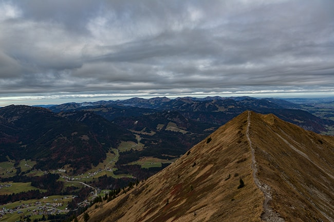 Path on the rim with Austria on the left and Germany on the right.  The mountains of Germany in the back