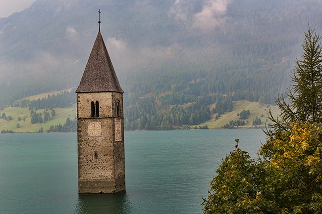 The fourteenth century bell tower of the town is all you can see after the  dam construction