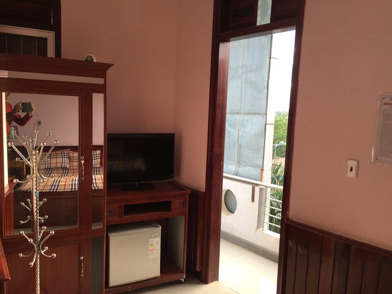 TV, fridge, closet and door to the balcony