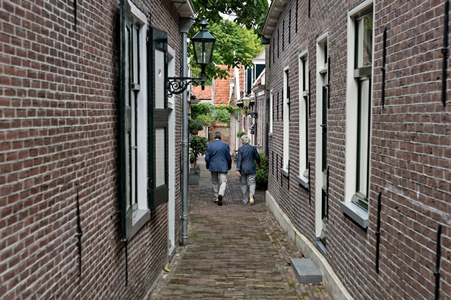 Lots of red brick buildings and narrow paths