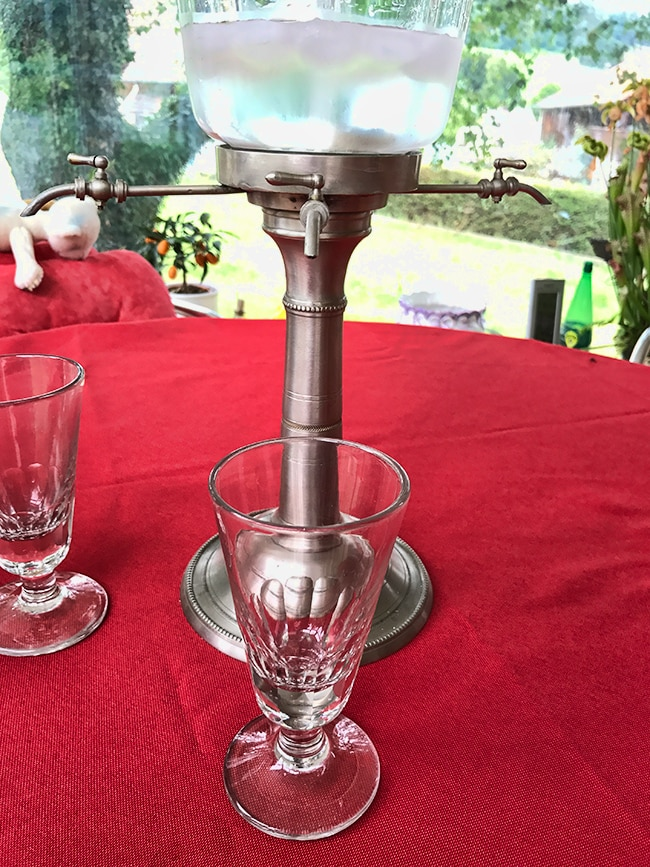 It serves up to 4 people. There is Absinthe in the glass
