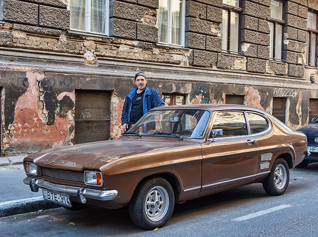 A 1969 Ford Capri. We had a Silver one when I was a kid. The lowest car on the streets at this time.