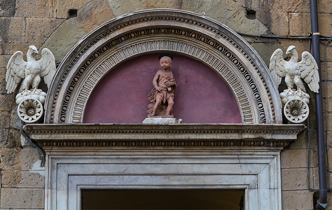 Pink Boy above an entrance next to the Colonna di S. Zanobi