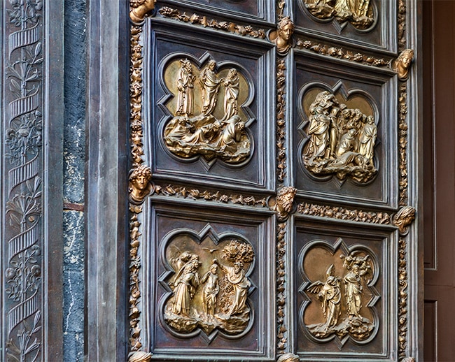 Detail of the South Door: He preaches to the Pharisees. He announces Christ. Baptism of his disciples. Baptism of Jesus.