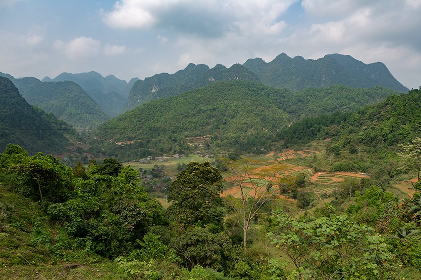Lots of green mountains left - view from the 34 a bit before Nguyen Binh